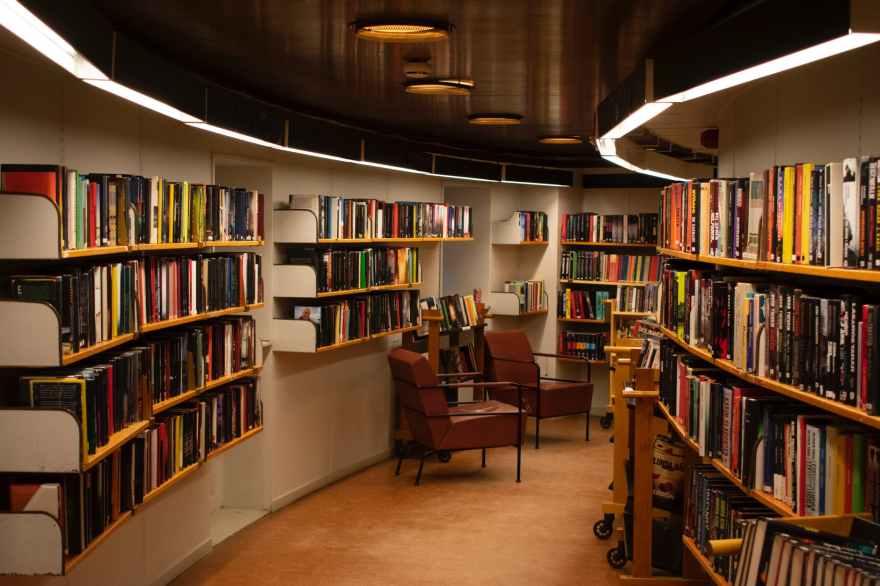 chair beside book shelves